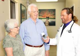 Dr. Sears with couple